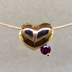 This lovely puffed heart pendant will make you feel happy every day.