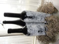 Spray paint wine bottles black. Spray with spray adhesive and roll in epsom salt. I used lavendar scented epsom salt (;