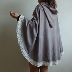 knitted poncho with cotton lace trim. black, white, or lilac wool; lots of color options in cotton jersey; and cashmere (i think that's the grey). a steal at $35 ($55 for the cashmere). so practical. i need this.