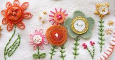 this just makes me happy!  what a wonderful combination of buttons, felt, and stitching!