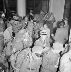 SS troops filing out on their way to captivity after being surrounded and forced to surrender in Milan.30 April 1945.
