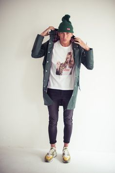 White & Green. Slim. Fit. Youth. Street. Fashion. Style. Clean. Modern. Big Print. Tee. Tight Jeans. Black. Worn. Sneakers. Kicks. Retro. Clothing. Rain Coat. Fresh. Outfit. Cap. Warm. WInter & Autumn.