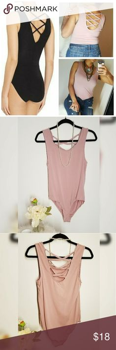 New Arrival!! Crisscross body Super soft, basic piece. A crisscross detail on the back, sleeveless, crotch buttons. Selling fast, only a few available. Camel color and pink blush perfect for spring ??? Tops