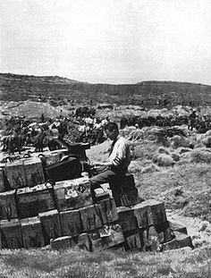 Ellis Ashmead-Barlett (1881-1931), British war correspondent, pictured at his typewriter resting on ammunition boxes after the landing at Anafarta, writing a despatch. His reports on the Gallipoli campaign for the Daily Telegraph, praised the Anzac troops and criticised the British commander, General Sir Ian Hamilton.