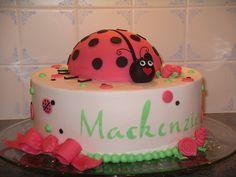 Pink Ladybug Cake - BC finish w/fondant on cake ladybug. Stenciled lettering.  Vanilla w/strawberry filling.