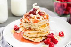 Macadamia Nut Pancakes with Raspberry Syrup and White Chocolate Shavings from French Toast, Cheesecake, Salad, and 20 Other Recipes to Make With Berries
