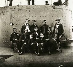 The crew of USS Monitor stands near the ship's turret after the Battle of Hampton Roads between Monitor and the Confederate navy ironclad CSS Virginia.
