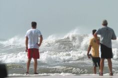 A group of people at Navarre Beach Park watched the high surf generated by Hurricane Katrina on Aug. 28. Daily News file photo, Aug. 29, 2005.