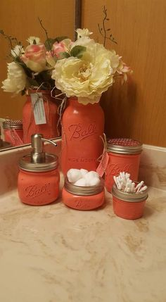 Set of 5 Coral Mason Jars: Set features 1-half gallon, 1-quart size, 1-pint (toothbrush holder) 1- 8oz (cotton balls) 1- 4oz (qtips) and 1- 16oz (soap pump). Each jar is painted with two coats of paint, distressed, and sealed with two coats of clear gloss. Jars can be used in any area of your home, for any style. Use them in one room or spread them out. **CLEANING- DO NOT SUBMERGE IN WATER OR PUT IN THE DISHWASHER. Gently wipe down with damp to dry rag**** These jars will ship 3 day…