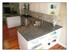 What the blue pearl granite will look like on the white cabinets