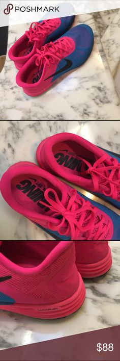 Nike running shoes Nike running shoes: hot pink and blue. Ordered these online.. loved them but it runs a little tight. I'm a size 9, fits like a 8.5 yo be extra comfy. Online tried on, never worn out Nike Shoes Athletic Shoes