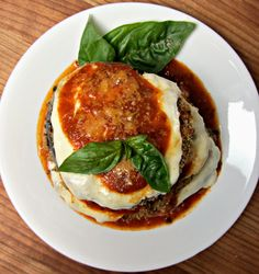 Ready in <30 min, Skinny Eggplant Parmigiana is a dish you can't resist! A baked version of the Italian classic, you'll love this light and lean dinner.