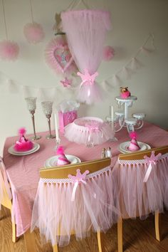 For Remy girl...I have lots of tulle left from a wedding...Tulle heart wreath, Tulle poms, Tulle chandelier, Tulle chair covers, OH MY! Looks so easy too!! A Princess party is definatly a must for any little girl!!