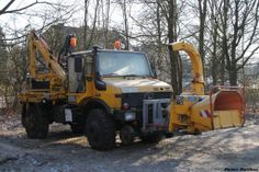 Unimog with boom crane and wood chipper