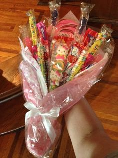 My 4 year old niece has a dance recital tonight. Instead of flowers, I decided to do a candy arrangement instead with assorted pink sweets and doublestick tape to hold it all together. Candy Bouquet Diy, Diy Bouquet, Bouquets, Dance Crafts, Candy Arrangements, Chocolates, Pink Sweets, Instead Of Flowers, Chocolate Bouquet