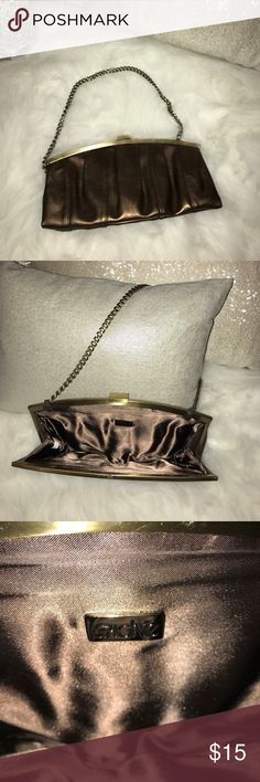 Cache - beautiful bronze purse! Used once! Pictures shown are with flash and without to give you a better idea of the color. Perfect for a night on the town! Cache Bags