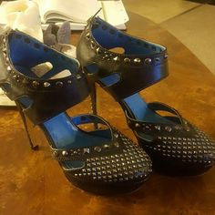 Shoe dazzle fearless studded black heels Amazing shoes. Studded along the front, back and ankle. Waiting for a new home. Heel height 5.5. Size 8.5 Shoe Dazzle Shoes Heels