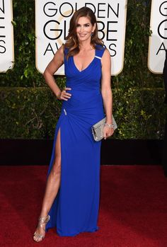 You can't keep former supermodel Cindy Crawford from strutting her stuff on the red carpet! The brunette beauty donned a blue Versace gown at the 2015 Golden Globe awards.
