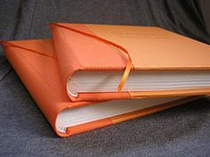 9 x 7 blank journals, all orange cover.