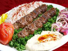 Lule Kebab Ground steak, rice, spiced onions, tomatoes, hummus and pickles. Mediterranean Armenian Food