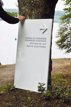 Could make something similar with stick on wooden arrows and whiteboard paint for flexible signage.