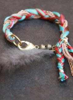 Friendship bracelet made with embroidery floss, gold chain, and leather cord.