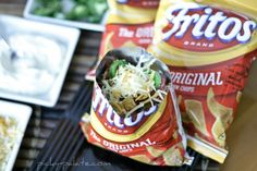 Walking tacos - excellent idea! I wouldn't even go to all the trouble of the recipe with all 18 ingredients.  I'd just get a packet of taco seasoning, beef, then use lettuce, tomatoes, cheese, jalapenos, and put your fixings in the bag with the fritos and let it rip!
