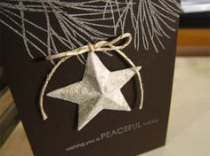 Paper white ink on brown cardstock. The star is a Savvy die.