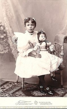 Victorian girl with large doll