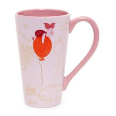 Pretty in pink is this Piglet mug, making tea time that bit brighter. Featuring two gloss designs of the cute little character, contrast interior and handle, it's adorably useful!