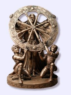 """Arianrhod Statue - Her silver wheel transforms the heavens and fate. Arianrhod is a Goddess of challenge and transformation. Her name translates to """"Silver Wheel"""", which we equate with the moon and stars and their cycles of change in the heavens. Her Twin Sons, Dylan and Llew, that she mysteriously bore, were given considerable obstacles to overcome by their Mother, who understood that attainment and status must be achieved by learning and effort."""