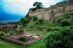 Ramkot Fort is an ancient fort situated in Azad Kashmir, Pakistan beside the Mangla Dam. It is accessible through boat and 13 kilometers away from Dina.and 79 km by road journey from mirpur(azad kashmir)to Dadyal village.and the fort is away from dadyal by walk 30 mins Located on the summit of a hill, Ramkot Fort is built over the site of an old Hindu Shiva temple. three sides of this hill top are surrounded by the River Jhelum.