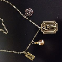 lock and key charm necklace with flower by FarmHouseJewels on Etsy