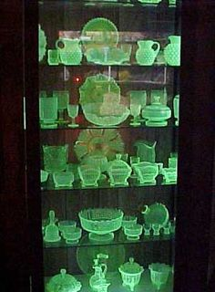 Glowing Vaseline glass, or Uranium glass. From the depression era and before. Glows like this under a black light. So Pretty.