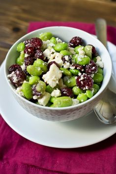 Edamame, Cranberry, & Feta Salad makes 6 servings  2 cups frozen shelled edamame 2 cups dried cranberries 1 tablespoon extra virgin olive oil freshly grated pepper to taste 1 cup crumbled feta cheese  Defrost edamame in microwave and allow to cool completely. Toss edamame and cranberries together with olive oil and pepper until combined. Gently stir in the feta cheese. Refrigerate until ready to serve.