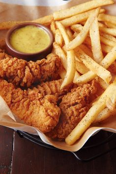 Crispy chicken tenders and french fries with salt and pepper. Pretty Foods & Pretty Drinks |pinterest.com/bjerkandera |