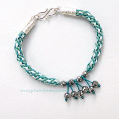 Three different thicknesses of S-On are worked together in this kumihimo bracelet by Pru McRae