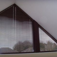 """The Bali LightBlocker 1"""" Angle Top Mini Blinds allow you to cover odd shaped windows without spending an arm and a leg."""