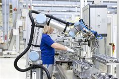 The car manufacturing group Volkswagen has integrated an industrial robotic arm from the Danish manufacturer Universal Robots into mass production at its engine production plant in Salzgitter, Germany. Industrial Robotic Arm, Industrial Robots, Daily Mail News, Lab Equipment, Industrial Revolution, Design Development, Workplace, Volkswagen, Technology