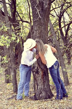 This would be cute without the kissing. Maybe standing on either side of the tree..?