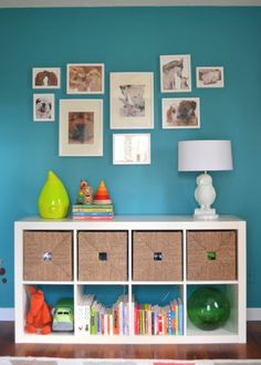 horizontal Ikea Expedit shelf- for boy's room. also the paint color would be good for strip.