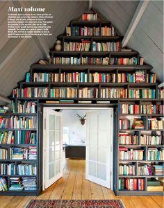 Well, that's one way to store books via Devon Rachel