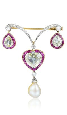A beautiful antique natural pearl, diamond, and ruby brooch.