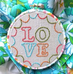 I ♥ how they wrapped the embroidery hoop in fabric!