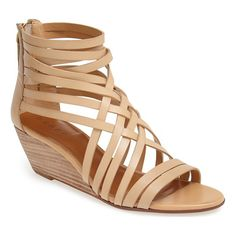 Interlaced leather straps top a breezy zip-back sandal lifted with a stacked woodgrain wedge.