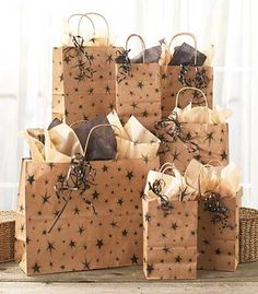 Wrap up any gift in the country style of the 28-pc. Rustic Star Kraft Bag Set. Stars dance over the bags, and the tissue paper coordinates with the bags for a w