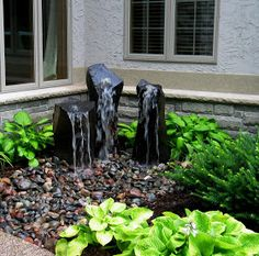 Pondless Water Fountain.  Such an elegant piece.  Waterfall add such a natural feel to any backyard! #waterfountains #fountains