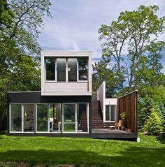 Bates Masi + Architects has designed Noyack Creek House for a New York actor. The site is a restrictive narrow lot fronting the tidal estuary of Noyack Creek. The house has 1,350 sq ft building size on 0,31 acres lot size. The space of the house is programmed as sequential space, adopting the professional life of the owner. [via] You might also like: Upcher, Prefabricated House Design by Bates Masi Harmony with Natural Environment – Small House on a River Treehouse – A Brig...