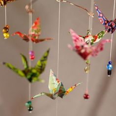 Origami mobile - my aunt made me a shoe box full of cranes. With a few beads, it could be really cool. I had always thought to use them as part of a valence. by Sonia ʚϊɞ Nesbitt