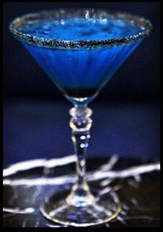 Bluewitch: Bacardi Dragon Berry Rum, Blue Curacao, Crème de banana, lime juice rimmed with black sugar